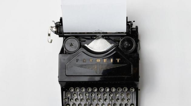 Top-down view of black and white typewriter.