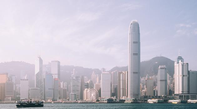 Skyline of Hong Kong with water with a boat in front