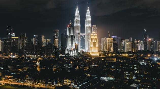 City lights with two tall buildings in Kuala Lumpur