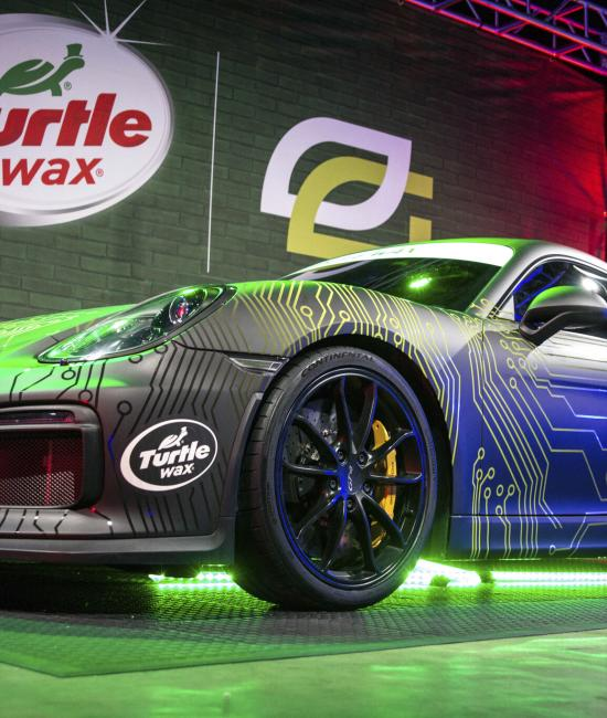 OpTic Gaming member Crimsix's custom-wrapped Porsche on display at a tournament